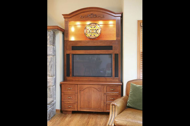 This Armoire was designed to fit in a specific location. It had to accommodate a flat screen TV and new surround sound speakers.