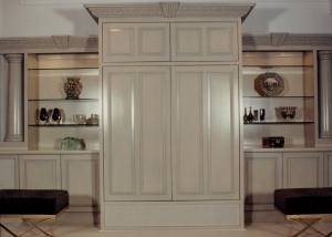 """Having done a large amount of work for an Interior Designer this unit was designed with her to go into her Family Room. The large center cabinet doors open and pocket back into the cabinet to reveal a flat screen TV and internal base cabinet for """"Hifi Components"""". The unit is select white maple with a custom light gray wiping stain."""
